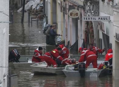 Red Cross teams evacuate businesses in the German town of Passau