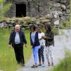 US First Lady Michelle Obama and her two daughters Malia (left) and Sasha listen to head tour guide George McClafferty explain about the historically important monastic site of Glendalough, Co Wicklow. (Pic: Julien Behal/PA Wire)