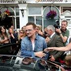 Bono leaves Finnegans Pub. (Image: Julien Behal/PA Wire)