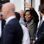 US First Lady Michelle Obama waves to the crowd as she leaves Finnegan's Pub in Dalkey. (Pic: Julien Behal/PA Wire)