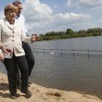 German Chancellor Angela Merkel and the the governor of Brandenburg state, Matthias Platzeck visit Wittenberge to get first hand information of the flood situation and to thank the volunteers who helped to fight against the floods.(AP Photo/Markus Schreiber)