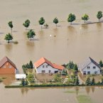 Houses stand in a flooded area by the River Elbe in the enclosed village Fischbeck, central Germany. (AP Photo/Jens Meyer)