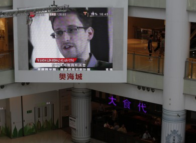A TV screen shows the news of Edward Snowden, a former CIA employee who leaked top-secret documents about US surveillance programs, at a shopping mall in Hong Kong.