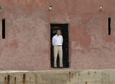 Barack Obama looks out to sea through the 'Door of No Return,' at the slave house on Goree Island, in Dakar, Senegal.