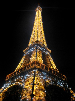 The Eiffel Tower sparkles in front of the night sky in Paris, France