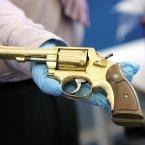 Golden revolver seized by Gardaí.<span class=