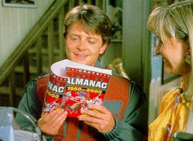 Mart McFly with the [now out of date] Gray's Sports Almanac.