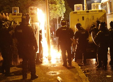 Riot police dealing with petrol bombs during violence earlier this month