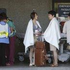 Passengers from Asiana Flight 214 are treated at San Francisco General Hospital after the plane crashed at San Francisco International Airport. (AP Photo/Bay Area News Group, John Green)