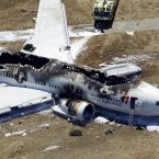 This aerial photo shows the wreckage of the Asiana Flight 214 airplane. (AP Photo/Marcio Jose Sanchez)