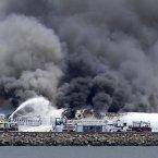 Fire crews work the crash site of Asiana Flight 214 at San Francisco International Airport in San Francisco. (AP Photo/Bay Area News Group, John Green)
