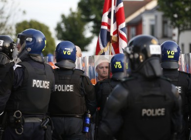 File image of an Orangemen confronting riot police in the Woodvale area of North Belfast on July 13.