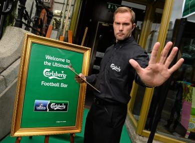 Jason McAteer posing as part of Carlsberg's Ultimate Foobtall Pub at 37 Dawson Street yesterday.