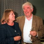 Heaney with his wife Maire on his return from Sweden in 1995. <span class=