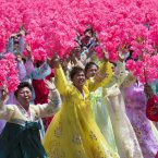 North Korean women wave to their leader Kim Jong Un during a mass military parade on Kim Il Sung Square in Pyongyang to mark the 60th anniversary of the Korean War armistice on July 27, 2013. (AP Photo/David Guttenfelder)