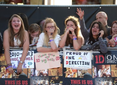 One Direction fans, probably tweeting.