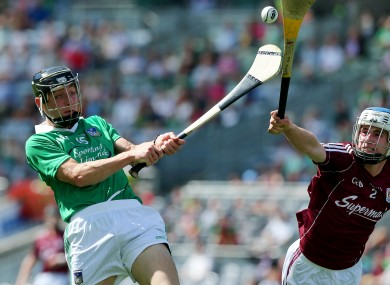 Limerick's Pat Ryan and Madhc O'Conghaile of Galway
