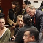 McCollum Connolly and Reid speak to lawyer Peter Madden. (AP Photo/Martin Mejia)<span class=