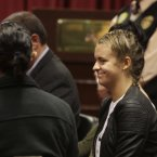Melissa Reid smiles as she arrive in court. (AP Photo/Martin Mejia)<span class=