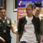 Michaella McCollum Connolly, right, and Melissa Reid are escorted by police as they arrive to court for their hearing in Callao, Peru, Wednesday, Aug. 21, 2013. Prosecutors formally levied drug-trafficking charges on Tuesday against Reid, of Scotland, and Connolly, of Ireland, who were arrested this month trying to depart Peru with 24 pounds of cocaine in their luggage. <span class=