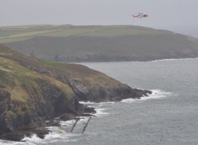 A Coast Guard helicopter hovers over the Astrid on 24 July