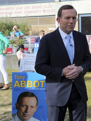 Tony Abbott arrives to cast his vote at Freshwater Surf Life Saving Club in Sydney earlier today.