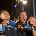 Dublin players Paul Flynn and Eoghan O'Gara sing along<span class=