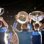 Dublin players show their trophy haul to the crowd<span class=
