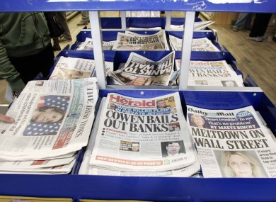 Newspaper headlines on the day of the guarantee.