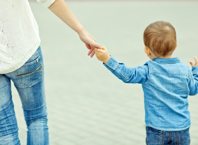 Holding a child's hand.