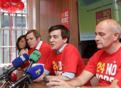IMO representatives, including Industrial Relations Assistant Director Eric Young (right)