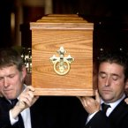 Seamus Heaney's coffin is carried from the Church of the Scared Heart in Donnybrook, Dublin by his sons Michael (left), Christopher (right).<span class=