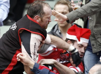 Toulouse's Trevor Brennan punches an Ulster's fans during a Heineken Cup match in 2007.