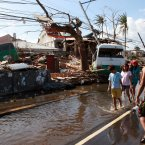 Residents surveying the damage caused by Super Typhoon Haiyan (local name Yolanda) in the city of Tacloban, Leyte, Philippines.<span class=