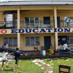 Children walking outside a school building damaged by Super Typhoon Haiyan in Santa Fe, Leyte, Philippines.<span class=