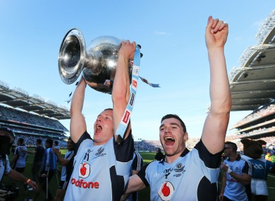 Ciaran Kilkenny and Paddy Andrews celebrate with the Sam Maguire cup after Dublin beat Mayo in the All-Ireland final.