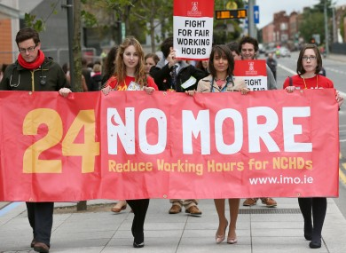 Non-consultant hospital doctors protest their long working hours in