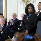 Former President Bill Clinton watches at left as President Barack Obama awards Oprah Winfrey with the Presidential Medal of Freedom.<span class=