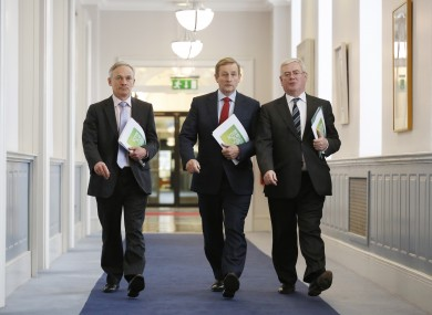 Richard Bruton, Enda Kenny and Eamon Gilmore at Government Buildings yesterday