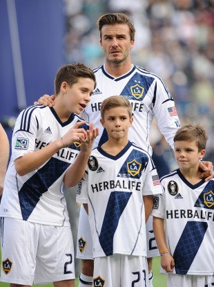 David Beckham with his sons (left to right) Brooklyn, Romeo and Cruz after the MLS Cup final.