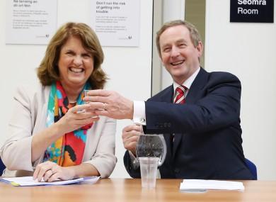 Minister Joan Burton shares a laugh with Taoiseach Enda Kenny.