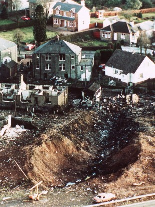 Wrecked houses and a deep gash in the ground in the village of Lockerbie in December 1988.