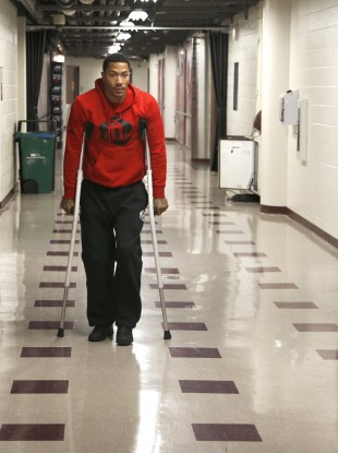 Chicago Bulls star Derrick Rose walks down the hall on crutches to a news conference  today.