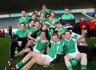 Geraldines' players celebrate with the trophy in Parnell Park.