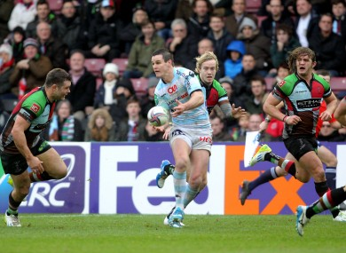 Jonny Sexton gets a pass away under the watchful eye of Nick Easter.