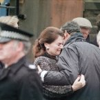 Two unidentified relatives of US crash victims, embrace each other after a Memorial Service in Lockerbie<span class=