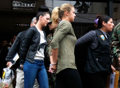 Michaela McCollum Connolly and Melissa Reid being escorted to a court appearance in August