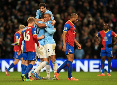 Edin Dzeko is swamped by teammates after scoring against Crystal Palace.