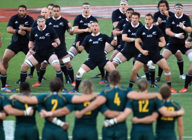 New Zealand's players peform a haka against South Africa during their Rugby Championship match at Ellis Park Stadium.