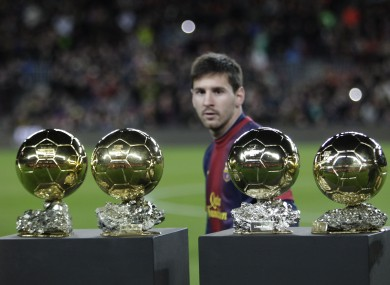 Messi with his four awards.